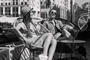 young female students relaxing in the sun - AdobeStock 121021573 scaled e1584714560534 300x200