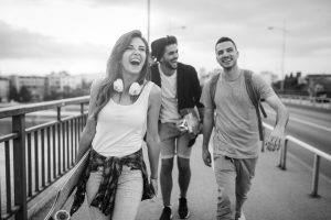 Group of happy friends hang out together - YoungPeopleWalking scaled e1583523052352 300x200
